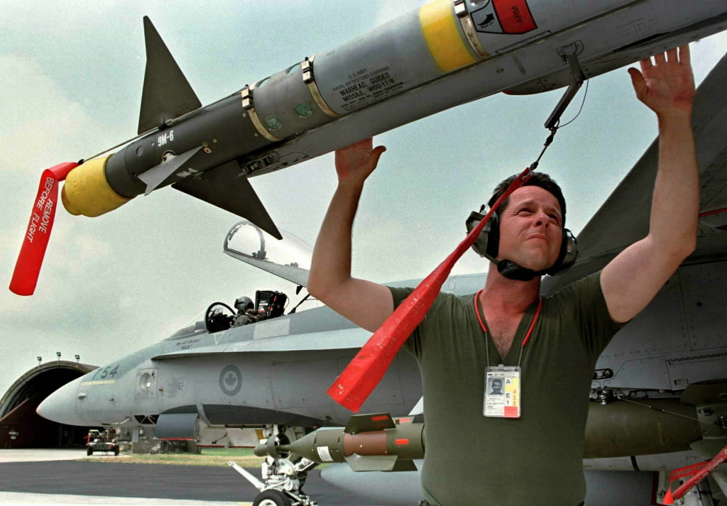 CANADIAN CF18 CREWMAN CHECKS SIDEWINDER MISSILE