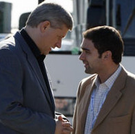 Conservative leader and Canada's PM Harper speaks with his press secretary Soudas in Saint-Hubert