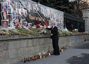 Prime Minister Stephen Harper lays a bouquet of flowers in Kiev, Ukraine, on Saturday, March 22, 2014. THE CANADIAN PRESS/Sean Kilpatrick