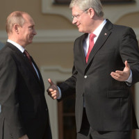 SAINT PETERSBURG - SEPTEMBER 05:  In this handout image provided by Host Photo Agency, Russian President Vladimir Putin (L) stands with Canadian Prime Minister Stephen Harper during an official welcome of G20 heads of state and government, heads of invited states and international organizations at the G20 summit on September 5, 2013 in St. Petersburg, Russia.  The G20 summit is expected to be dominated by the issue of military action in Syria while issues surrounding the global economy, including tax avoidance by multinationals, will also be discussed duing the two-day summit.  (Photo by Ramil Sitdikov/Host Photo Agency via Getty Images)