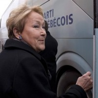 Parti Quebecois Leader Pauline Marois walks to her campaign bus following a news conference, Tuesday, March 11, 2014 in Becancour, Que. Quebecers are going to the polls on April 7. THE CANADIAN PRESS/Jacques Boissinot