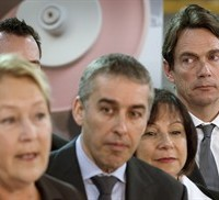 Media baron and PQ candidate Pierre Karl Peladeau, right, stands behind PQ leader Pauline Marois and candidates, March 10, 2014 in Saint-Bruno-de-Montarville, Que. THE CANADIAN PRESS/Paul Chiasson
