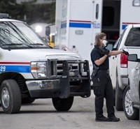 Police investigator at the scene of a multiple fatal stabbing in northwest Calgary, Alberta on Tuesday, April 15, 2014. Police say five people are dead after a stabbing at a house party. THE CANADIAN PRESS/Larry MacDougal