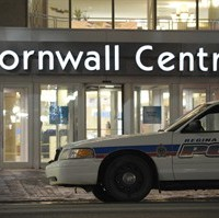 A police car sits outside the Cornwall Centre in Regina on Tuesday April 15, 2014. Four people have been injured in an apparently random stabbing incident at a downtown shopping centre in Regina. THE CANADIAN PRESS/Michael Bell