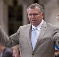 Conservative MP Ted Menzies responds during question period in Ottawa on June 12, 2012. THE CANADIAN PRESS/Adrian Wyld