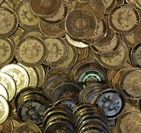 "This April 3, 2013 file photo shows bitcoin tokens in Sandy, Utah. The lack of regulation and high level of anonymity of Bitcoins may make the virtually currency ""an attractive payment method for criminals,"" former finance minister Jim Flaherty was warned by senior officials in a recently declassified memo. THE CANADIAN PRESS/AP/Rick Bowmer"