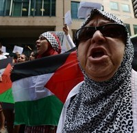 People take part in a protest and march in Ottawa on Tuesday July 22, 2014, calling for Canada to defend human rights in Palestine. THE CANADIAN PRESS/Sean Kilpatrick