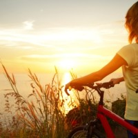 cycling-woman-sunset
