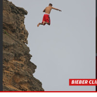 0819-bieber-cliff-jumping-splash-4