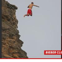 0819-bieber-cliff-jumping-splash-4