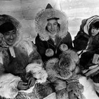 """Prime Minister Pierre Trudeau sits in an igloo in Spence Bay during his visit to the arctic, March 10, 1970. A declassified CIA report says Pierre Trudeau's bid to enhance Canadian sovereignty and promote economic development in the Arctic created some """"friction"""" with the United States. THE CANADIAN PRESS/Peter Bregg"""