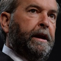 NDP Leader Tom Mulcair addresses the Canadian Medical Association's annual meeting in Ottawa on Wednesday morning, Aug. 20, 2014. THE CANADIAN PRESS/Sean Kilpatrick