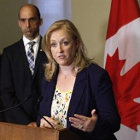 Transport Minister Lisa Raitt speaks to the media with Minister of Public Safety Steven Blaney following the release of the Transportation Safety Board's final report from its investigation into the July 6, 2013 train derailment in Lac-Megantic, Quebec, on Parliament Hill in Ottawa on Tuesday, August 19, 2014. THE CANADIAN PRESS/Patrick Doyle