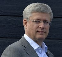 Canadian Prime Minister Stephen Harper listens to a speaker during an event at the Yukon college in Whitehorse, Thursday August 21, 2014. THE CANADIAN PRESS/Adrian Wyld