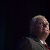 "Mayor Rob Ford pauses while participating in a mayoral debate in Toronto on Tuesday, July 15, 2014. Ford has been diagnosed with a tumour after seeking treatment for ""unbearable'' abdominal pain. THE CANADIAN PRESS/Darren Calabrese"
