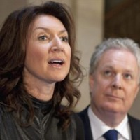 Deputy premier Nathalie Normandeau announces her resignation as Quebec Premier Jean Charest looks up, at a news conference at the legislature in Quebec City on September 6, 2011. A spokesman for Nathalie Normandeau says the federal Liberals have approached the ex-deputy premier about running for them in eastern Quebec. THE CANADIAN PRESS/Jacques Boissinot