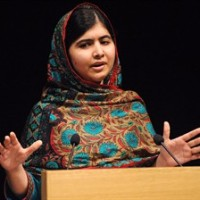 Pakistani schoolgirl Malala Yousafzai speaks during a media conference at the Library of Birmingham, in Birmingham, England, Oct.10, 2014. Prime Minister Stephen Harper's office says two scheduled events today in Toronto with Nobel Peace Prize winner Malala Yousafzai have been cancelled. THE CANADIAN PRESS/AP/Rui Vieira