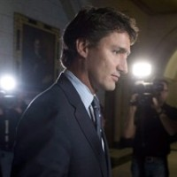 Liberal Leader Justin Trudeau speaks with the media following party caucus in Ottawa on October 8, 2014. Justin Trudeau projects the image of a self-assured, impeccably turned-out, celebrity heart throb. But it wasn't always that way.By the Liberal leader's own account, he was an awkward, insecure, pimply-faced youth who was traumatized by his parents' very public split and his mother's mental illness, an indifferent student who struggled in the shadow of his famous father to find his own metier. THE CANADIAN PRESS/Adrian Wyld
