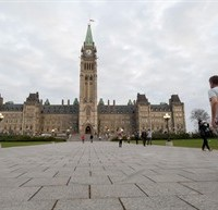A runner makes his way towards Centre Block on Parliament Hill in Ottawa on Saturday, Oct. 25, 2014. The grounds and lawn of Parliament Hill reopened Friday night following the shootings at the National War Memorial and inside Centre Block. THE CANADIAN PRESS/Justin Tang