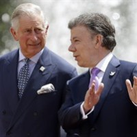 Colombia's President Juan Manuel Santos, right, talks to Britain's Prince Charles during a welcoming ceremony at the presidential palace in Bogota, Colombia, Wednesday, Oct. 29, 2014. Prince Charles has made what is being described as a substantial donation to the families of the two Canadian soldiers killed recently in separate attacks. THE CANADIAN PRESS/AP/Fernando Vergara