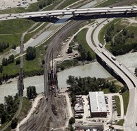 The Bonnybrook rail bridge, centre, that was the scene of a bridge failure, is seen from the air in Calgary, Alta., Thursday, July 11, 2013. The Transportation Safety Board of Canada is to release its report Wednesday about a bridge failure and freight train derailment in Calgary during a devastating flood. THE CANADIAN PRESS/Jeff McIntosh