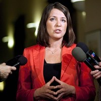 Wildrose Party Leader Danielle Smith is shown speaking to reporters in Calgary, Alta., Thursday, Jan. 24, 2013. Sources have told The Canadian Press that seven members of Wildrose Leader Danielle Smith's party — including Smith herself — want to join Prentice's Tory government. THE CANADIAN PRESS/Jeff McIntosh