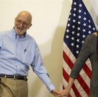 Alan Gross smiles as he walks in with his wife Judy before speaking to members of the media at his lawyer's office in Washington, Wednesday, Dec. 17, 2014. Gross was released from Cuba after 5 years in a Cuban prison. (AP Photo/Pablo Martinez Monsivais)