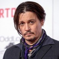 "Cast member Depp poses at the premiere of ""Mortdecai"" at the TCL Chinese theatre in Hollywood"