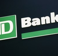 In this Nov. 12, 2009 file photo, a sign for TD Bank is shown in New York. TD Bank is cutting its 2015 forecast for Canada's economy due to the drop in oil prices and predicting that the Bank of Canada will cut its key interest rate by another quarter of a percentage point in March.THE CANADIAN PRESS/AP, Mark Lennihan