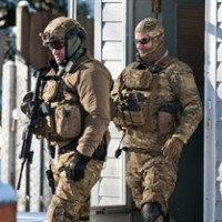 RCMP officers perform door-to-door checks on Cedar Street in Moncton, N.B., on Sunday, Jan.25, 2015 after reports of a man walking around with a weapon. THE CANADIAN PRESS/Marc Grandmaison