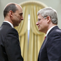Canada's PM Harper congratulates Public Safety Minister Steven Blaney after he was sworn in during a ceremony at Rideau Hall in Ottawa