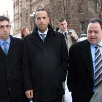 "Alexander (Sandro) Lisi (centre) leaves court in Toronto on Monday, March 2, 2015 with his lawyers Seth Weinstein (left) and Domenic Basile. Lisi, 36, is charged with extortion in relation to the infamous ""crack video"" of former mayor Rob Ford allegedly using smoking crack cocaine. THE CANADIAN PRESS/Colin Perkel"