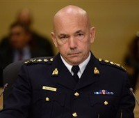 RCMP Commissioner Bob Paulson appears at Senate National Security and Defence committee in Ottawa on Monday, Oct. 27, 2014. Paulson will use an open meeting of the House of Commons public safety committee to provide an update into the investigation of the Oct. 22 attack that killed Cpl. Nathan Cirillo. THE CANADIAN PRESS/Sean Kilpatrick