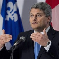 Coalition Avenir Quebec MNA Gerard Deltell announces he's quitting the CAQ and joining the Conservative Party of Canada for the upcoming federal election, Tuesday, April 7, 2015 in Quebec City. THE CANADIAN PRESS/Jacques Boissinot