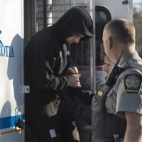 One of four members of the British navy, in Nova Scotia for a hockey tournament with local military personnel, arrives at provincial court in Dartmouth, N.S. on Monday, April 20, 2015. The men face charges of sexual assault following an alleged incident at a Canadian Forces base in Halifax. THE CANADIAN PRESS/Andrew Vaughan