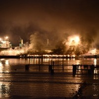Dark and smelly smoke from a fire at a deep-water port billowed over the town of Squamish, B.C., Thursday night April 16, 2015, forcing municipal officials to ask residents to stay indoors. THE CANADIAN PRESS/Silvester Law