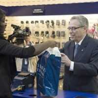Federal Finance Minister Joe Oliver purchases his new budget shoes during a photo op in Toronto on Monday, April 20, 2015. THE CANADIAN PRESS/Frank Gunn