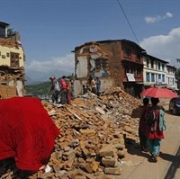 Nepalese people salvage belongings from the debris of their house damaged in last week earthquake in Chautara, Sindhupalchok district, Nepal, Saturday, May 2, 2015. The federal government says Canada's Disaster Assistance Response Team will be deployed immediately to earthquake-stricken Nepal. Officials say DART members from Canadian Forces Base Trenton will be heading to Nepal, along with civilian political and humanitarian personnel from Foreign Affairs. THE CANADIAN PRESS/AP, Manish Swarup