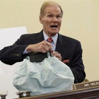Senate Commerce Committee member Sen. Bill Nelson, D-Fla. displays the parts and function of a defective airbag made by Takata of Japan that has been linked to multiple deaths and injuries in cars driven in the US, during the committee's hearing on Capitol Hill in Washington, Nov.20, 2014. The federal government says an expanded recall of faulty Takata airbags covers about 1.2 million vehicles in Canada. THE CANADIAN PRESS/AP/J. Scott Applewhite