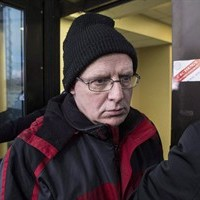 Benjamin Levin, a former Ontario deputy minister of education and a former professor at University of Toronto, is shown leaving a Toronto court on Tuesday, March 3, 2015 after pleading guilty to three charges relating to child pornography. THE CANADIAN PRESS/Chris Young