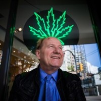 Don Briere, owner of 15 Weeds Glass & Gifts medical marijuana dispensaries, stands for a photograph outside one of his locations in downtown Vancouver, B.C., on Friday May 1, 2015. THE CANADIAN PRESS/Darryl Dyck