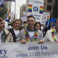 Ontario PC Leader Patrick Brown (centre) walks the route during Toronto's Pride Parade on Sunday June 28, 2015. THE CANADIAN PRESS/Chris Young