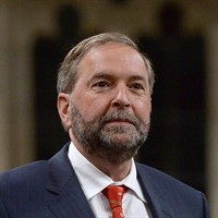 NDP Leader Tom Mulcair asks a question during question period in the House of Commons on Parliament Hill in Ottawa on June 15, 2015. A report published online by Maclean's magazine says NDP Leader Thomas Mulcair was in discussions in 2007 to join the Conservative party as a senior adviser on the environment to Prime Minister Stephen Harper. THE CANADIAN PRESS/Sean Kilpatrick