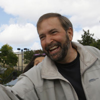 New Democratic Party (NDP) candidate Thomas Mulcair greets people at a community fair while campaigning in his riding of Outremont in Montreal, September 16, 2007. Quebec voters will go to the polls in three federal by-elections on September 17. (Shaun Best/Reuters)