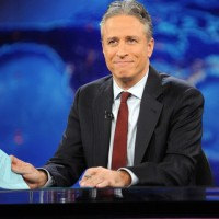 "FILE - This Nov. 30, 2011 file photo shows television host Jon Stewart during a taping of ""The Daily Show with Jon Stewart"" in New York.  Stewart says Aug. 6, 2015 will be his last night hosting Comedy Central's ""The Daily Show."" Stewart set the date in the closing moments of Monday, April 20 edition of the parody newscast. (AP Photo/Brad Barket, file)"