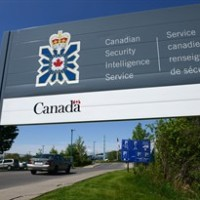FILE -- A sign for the Canadian Security Intelligence Service building is shown in Ottawa, Tuesday, May 14, 2013. Newly released memos show Canada's spy agency revealed its interest in people to foreign partners in two cases after receiving assurances the individuals would not be tortured - a practice human rights advocates say shirks the law and puts vulnerable detainees at risk. THE CANADIAN PRESS/Sean Kilpatrick