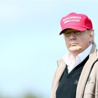 Presidential contender Donald Trump looks on at the 16th green on the 1st first day of the Women's British Open golf championship on the Turnberry golf course in Turnberry, Scotland, Thursday, July 30, 2015. Trump has jumped to a lead in early polls for the Republican party's 2016 presidential nomination, thanks partly to grassroots conservatives who love his tough talk about illegal immigrants and career politicians. THE CANADIAN PRESS/AP, Scott Heppell