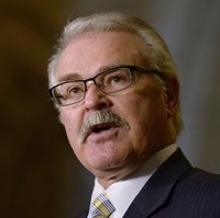 Agriculture Minister Gerry Ritz responds to questions about trade with the United States during a news conference on Parliament Hill in Ottawa, Tuesday, May 19, 2015. Ritz says Ottawa is granting tax deferrals to western livestock producers in regions hit by drought. THE CANADIAN PRESS/Adrian Wyld