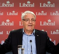 Liberal MP Marc Garneau holds a news conference to discuss the cost of Prime Minister Stephen Harper making an early election call, in Ottawa, Friday, July 31, 2015. THE CANADIAN PRESS/Fred Chartrand