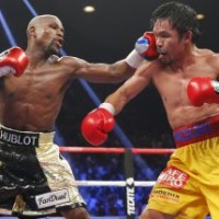 Floyd Mayweather, Jr. (L) of the U.S. lands a left to the face of Manny Pacquiao of the Philippines in the 11th round during their welterweight WBO, WBC and WBA title fight in Las Vegas, Nevada, in this May 2, 2015 file photo.  Boxers Mayweather and Pacquiao topped Forbes 2015 list of the world's highest-paid celebrities June 29, 2015, thanks to their record-breaking lucrative Las Vegas fight that assured them earnings that surpassed those of musicians and actors.  REUTERS/Steve Marcus/Files